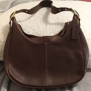 Coach glove tanned brown leather purse.